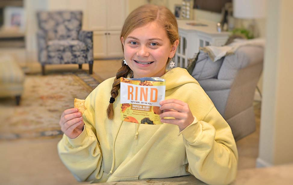 picture of girl with RIND snacks